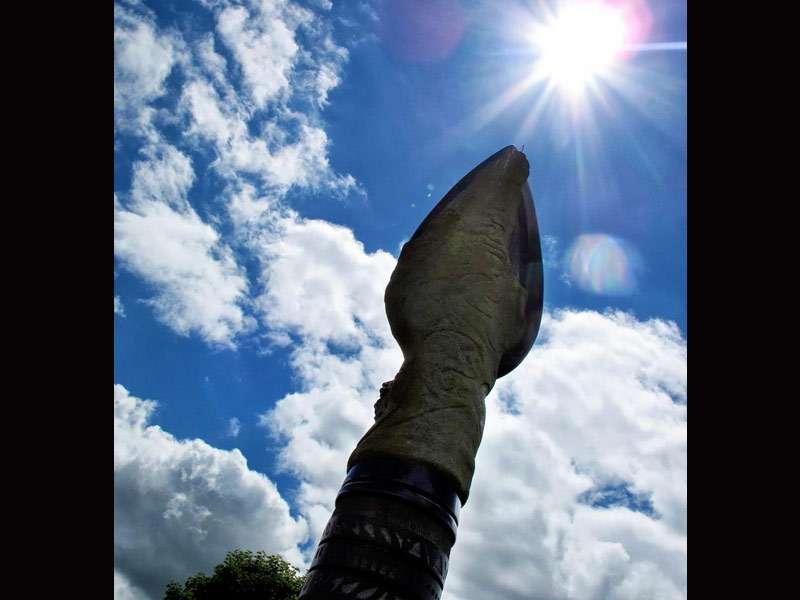 The sun over the Dun Ailinne spear monument on Midsummer Day 2013